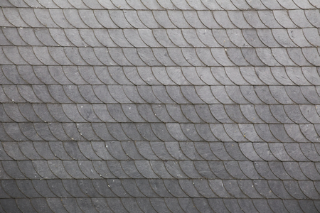 Slate roof tiles with a horizontal arrangement.