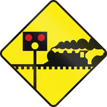amber light: Warning road sign in Ireland - Level crossing with signals ahead.