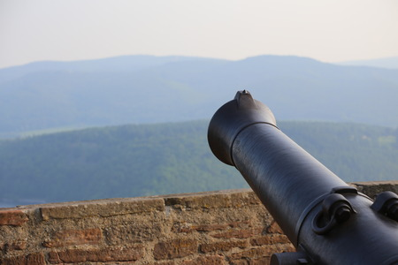 image created 21st century: View over the mountains in Hesse, Germany, besides an old-fashioned cannon.
