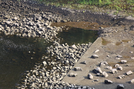 image created 21st century: Stones and concrete on the edge of a river in Germany. Stock Photo