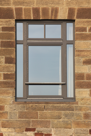 image date: Facade made from freestones with a common modern window. Stock Photo