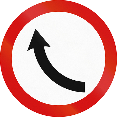 single object: Obsolete Irish road sign at a curve. Stock Photo