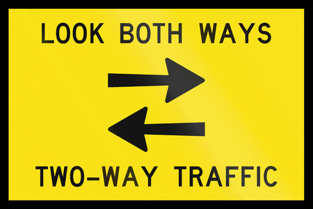 An Australian temporary road sign - Look both ways, two-way traffic