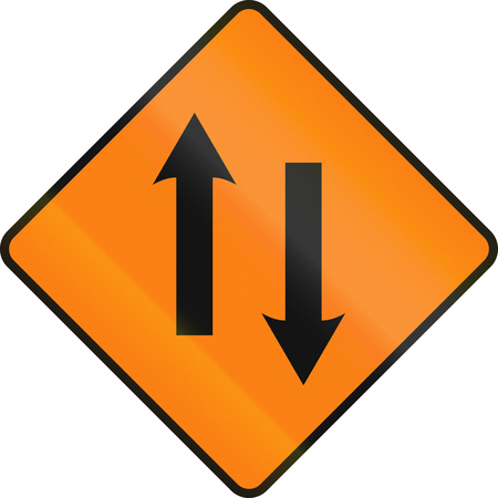 one lane road sign: An Irish temporary road sign - Two lane area ahead Stock Photo