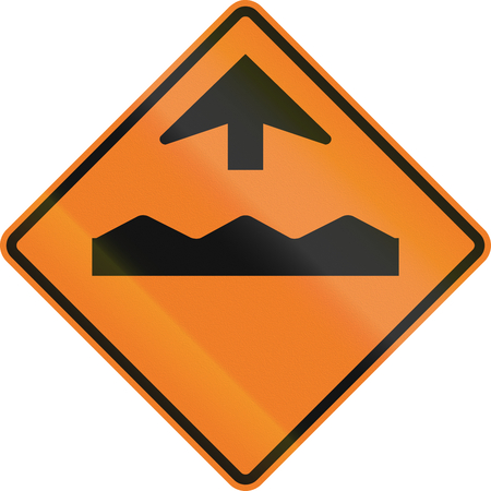 road ahead: Canadian temporary road warning sign - Rough road ahead. This sign is used in Ontario. Stock Photo