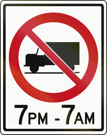ontario: Canadian traffic sign prohibiting thoroughfare of lorries in specified times. This sign is used in Ontario. Stock Photo