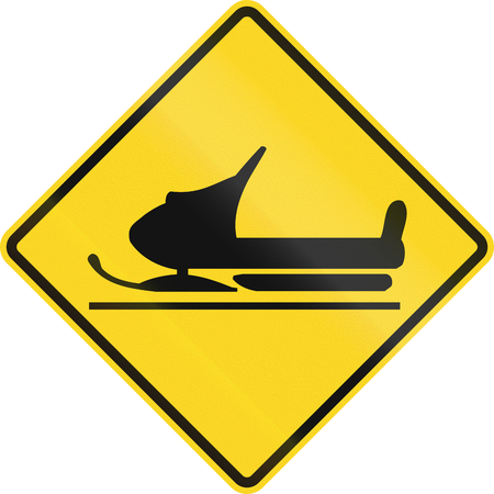skidding: Warning road sign in Canada - Snowmobiles crossing. This sign is used in Ontario. Stock Photo