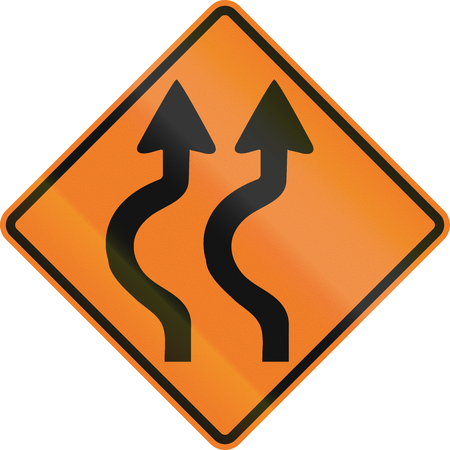 left handed: Canadian traffic warning sign - Double two reverse curve to the left. This sign is used in Ontario. Stock Photo