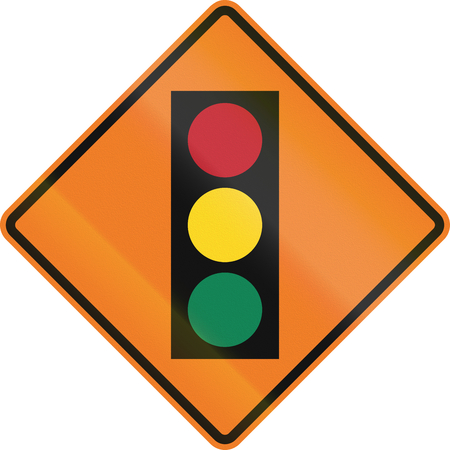 warning lights: Canadian temporary road warning sign - Traffic lights ahead. This sign is used in Ontario. Stock Photo
