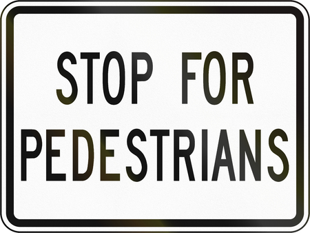 requiring: Supplementary plate for crosswalk signs in Canada, requiring drivers to stop fully for pedestrians crossing. This sign is used in Ontario. Stock Photo
