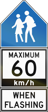 kmh: Canadian regulatory road sign - Maximum 60 kmh when flashing, old version. This sign is used in Ontario. Stock Photo