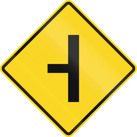 routing: Canadian road warning sign - T-Intersection ahead. This sign is used in Ontario. Stock Photo