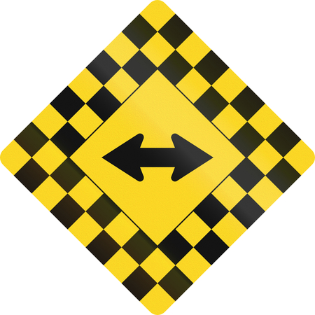right handed: Checked warning road sign in Canada with keep left or right arrow. This sign is used in Ontario.
