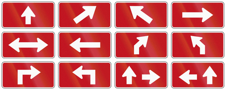 supplemental: Set of red arrow signs used as supplemental traffic signs in Quebec, Canada.