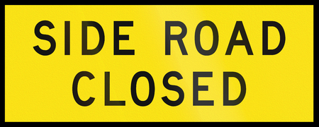 side of the road: An Australian temporary road sign - Side road closed