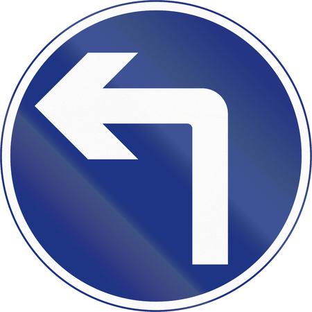 turn left sign: Irish traffic sign - Turn left ahead Stock Photo
