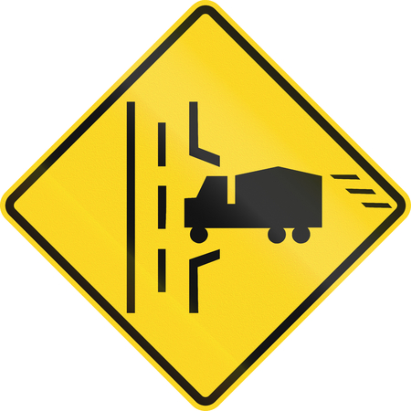 right handed: Warning road sign in Canada - Truck entrance on the right. This sign is used in Ontario.