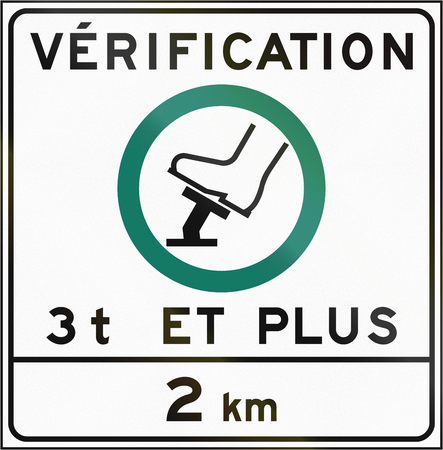 compulsory: Regulatory road sign in Quebec, Canada - Compulsory brake check for 3 tons and more. The text means: Verification - 3 t and more. Stock Photo