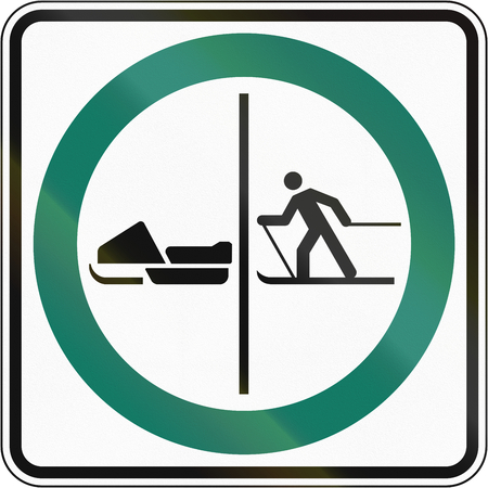 one lane roadsign: Regulatory road sign in Quebec, Canada - Skier and snowmobile lane. Stock Photo