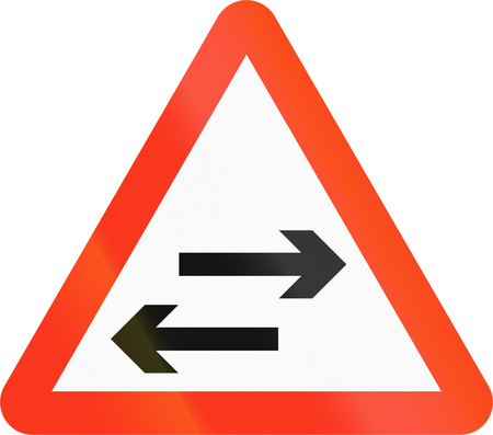 red handed: Bangladeshi sign warning about two-way traffic on a two-way road.