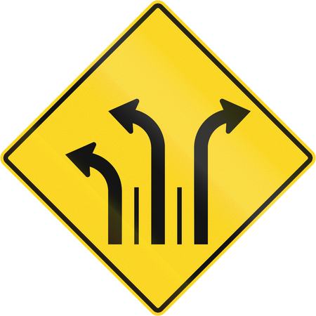 marking up: Warning road sign in Quebec, Canada - Three lanes with right and left turn lane. Stock Photo