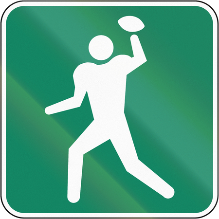 american football ball: Guide and information road sign in Quebec, Canada - Football field.