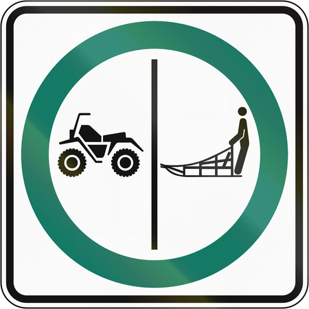 one lane road sign: Regulatory road sign in Quebec, Canada - Sled and ATV lane.