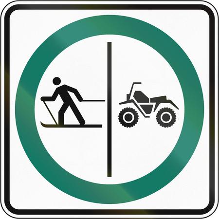one lane roadsign: Regulatory road sign in Quebec, Canada - Skier and ATV lane.