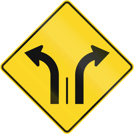 right handed: Warning road sign in Quebec, Canada - Two lanes with right and left turn lane.