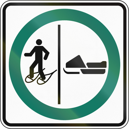 one lane road sign: Regulatory road sign in Quebec, Canada - Snowshoeing and snowmobile lane.
