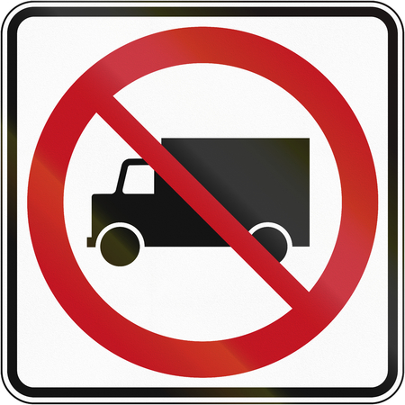 quebec: Canadian traffic sign prohibiting thoroughfare of lorries. This sign is used in Quebec. Stock Photo