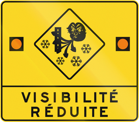 reduced: Warning road sign in Quebec, Canada - reduced visibility.