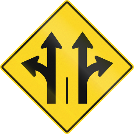 right handed: Warning road sign in Quebec, Canada - Two lanes with straight and turn lane. Stock Photo
