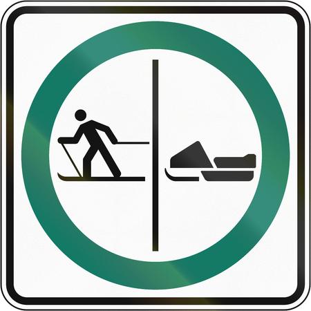 Regulatory road sign in Quebec, Canada - Skier and snowmobile lane. Zdjęcie Seryjne