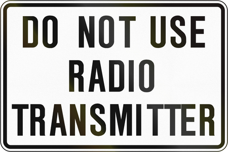 transmitter: An Canadian temporary road sign - Resume use of radio transmitter. This sign is used in Ontario. Stock Photo