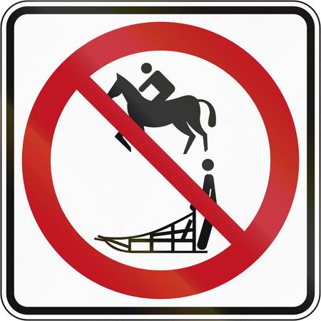 no skid: Regulatory road sign in Quebec, Canada - No equestrians and sleds.