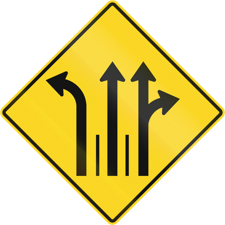 marking up: Warning road sign in Quebec, Canada - Three lanes with left turn lane. Stock Photo