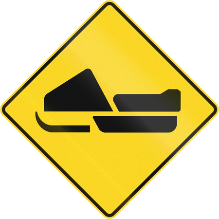 no skid: Warning road sign in Canada - Snowmobiles crossing. This sign is used in Quebec.