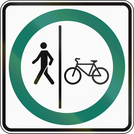 shared: Regulatory road sign in Quebec, Canada - Shared use path with separate lanes.