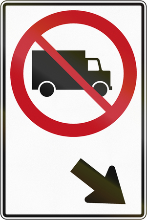 quebec: Canadian traffic sign prohibiting thoroughfare of lorries on the right. This sign is used in Quebec. Stock Photo