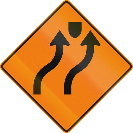 right handed: Canadian road warning sign - Two lane reverse Curve With Median. This sign is used in Quebec.