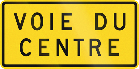 supplemental: Supplemental warning road sign in Quebec, Canada - Center Lane.
