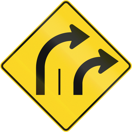 lanes: Warning road sign in Quebec, Canada - Two lanes turn right. Stock Photo