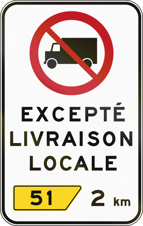 regulatory: Canadian regulatory traffic sign - No lorries. The text means: Except local delivery. This sign is used in Quebec. Stock Photo