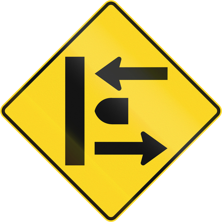 the carriageway: An Canadian warning traffic sign - Intersection at dual carriageway. This sign is used in Quebec. Stock Photo