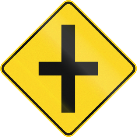 routing: Canadian road warning sign - 4-way Intersection ahead. This sign is used in Quebec.