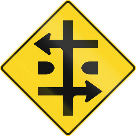 carriageway: An Canadian warning traffic sign - Intersection at dual carriageway. This sign is used in Quebec. Stock Photo