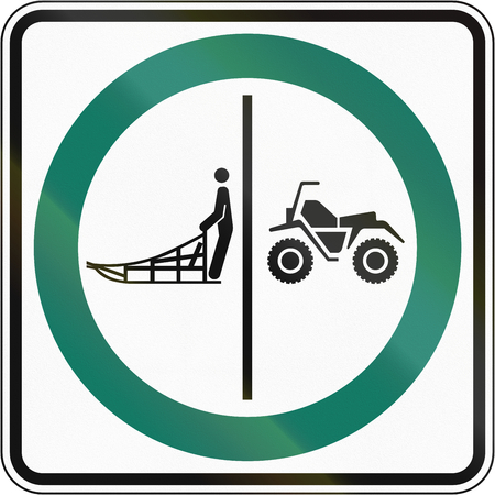 no skid: Regulatory road sign in Quebec, Canada - Sled and ATV lane.
