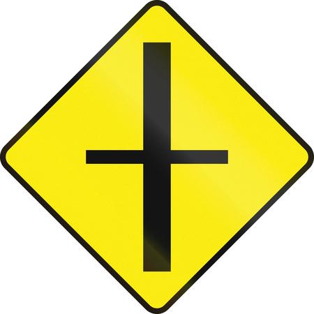 rhomb: Irish road warning sign - 4-way Intersection ahead Stock Photo