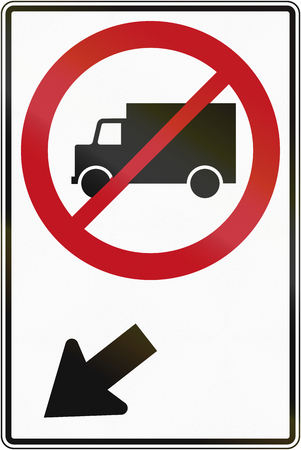 Canadian traffic sign prohibiting thoroughfare of lorries on the left. This sign is used in Quebec.